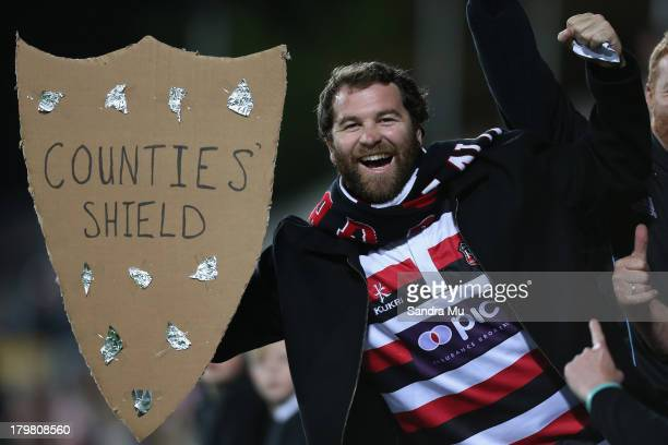 Counties Manukau fan celebrates the Ranfurly Shield win during the Rugby Championship between the New Zealand All Blacks and Argentina at Waikato...
