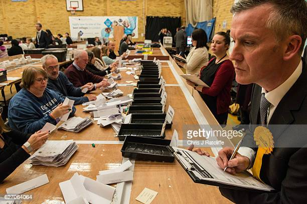 A counting agent for Liberal Democrat candidate Sarah Olney watches over count staff during the Richmond Park byelection count at Richmond Upon...