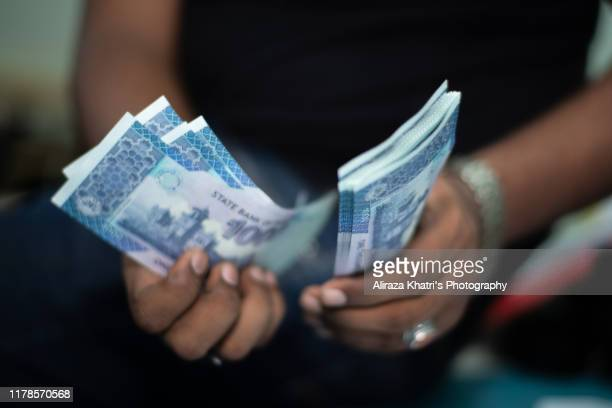 counting money - pakistan stock pictures, royalty-free photos & images