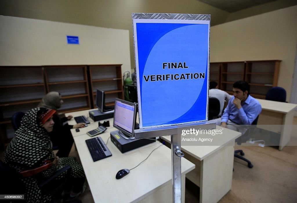 Counting of the votes is about to start of presidential election in Kabul, Afghanistan on 16 June, 2014. Preparations are completed in the centre where officials count the votes. After officials get the ballot boxes, they enter the data of election results into the computer.