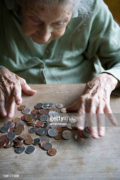 counting pennies - counting stock pictures, royalty-free photos & images
