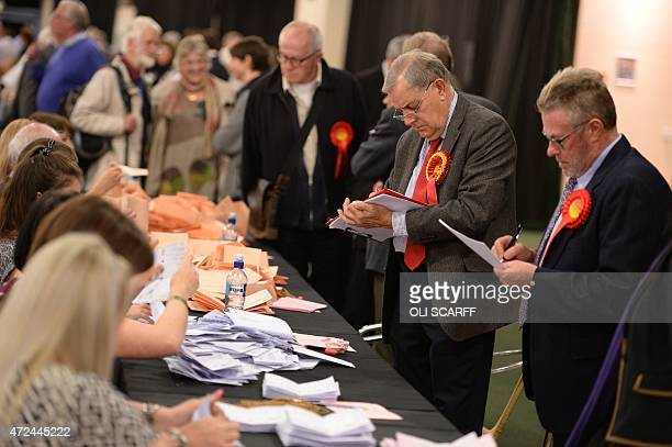 Counting staff and party representatives work at the counting centre at Doncaster Racecourse northern England on May 7 2015 after polls closed in the...