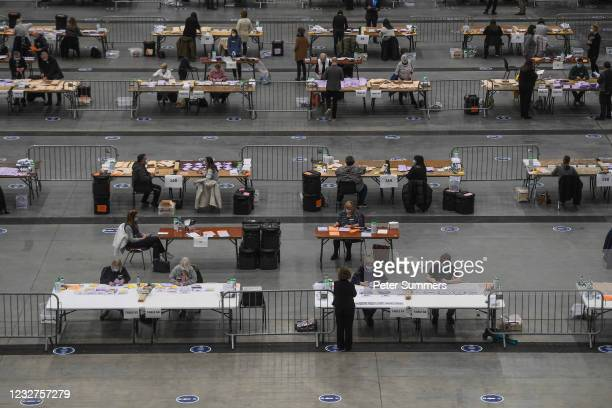 Counting staff are seen counting ballots on May 8, 2021 in Aberdeen, Scotland. Voting has concluded in the Scottish Parliament election, A record...