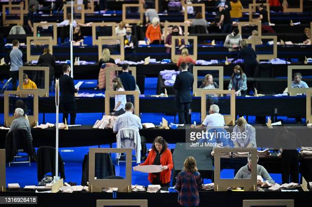 Counting staff continue counting ballots for a second day at Glasgow counting centre in the Emirates Arena on May 08, 2021 in Glasgow, Scotland. All...
