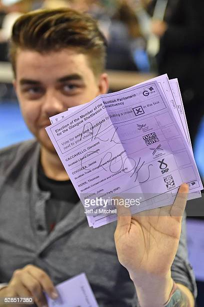 Counting staff hold up a spoiled ballot paper in the Scottish Parliament elections at the Emirates Arena on May 5 2016 in GlasgowScotland The first...