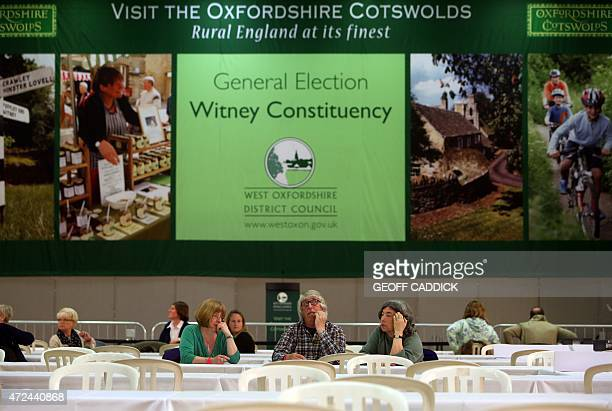 Counting staff wait for the arrival of the first ballot boxes at the counting centre set up at the Windrush Leisure Centre Witney northwest of London...