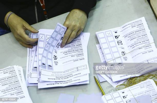 Counting takes place during the first round of the West Midlands mayoral elections at the Barclaycard Arena in central Birmingham on May 5 2017 / AFP...