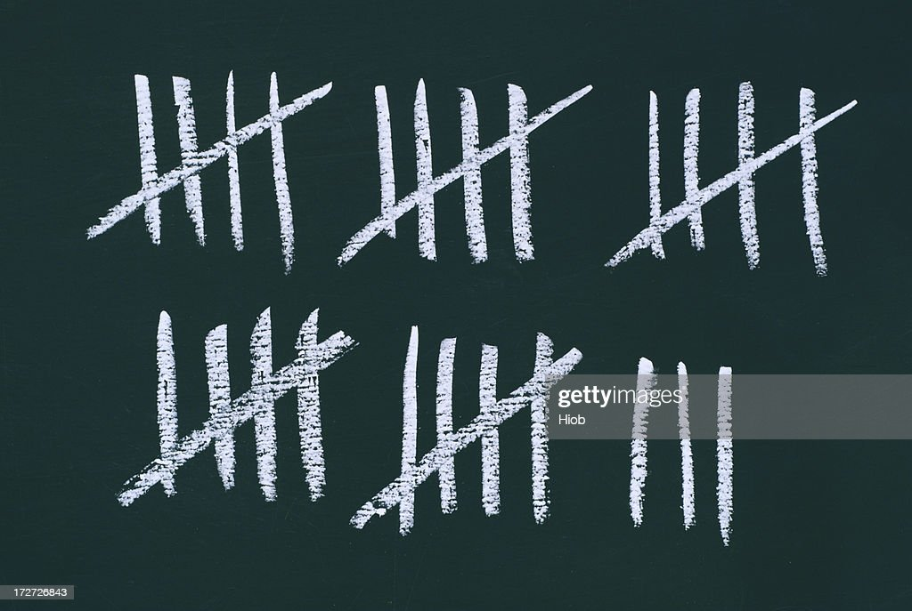 counting the days - stripes on a blackboard : Stock Photo