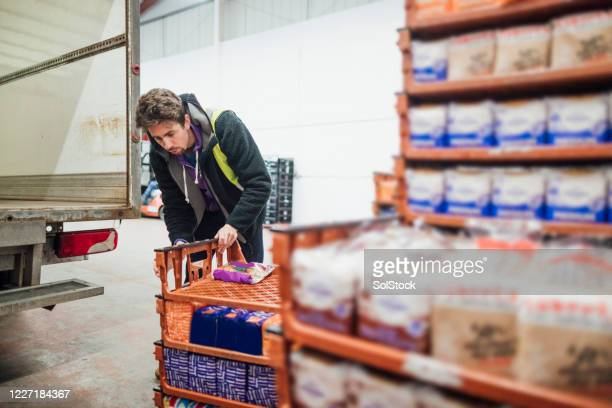 counting the loaves - essential services stock pictures, royalty-free photos & images