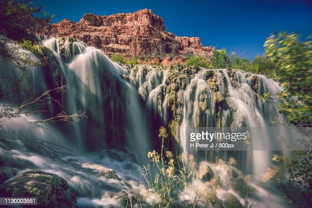 countless braids of waterfalls - havasu creek stock photos and pictures