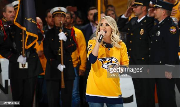 Country artist and wife of Mike Fisher of the Nashville Predators Carrie Underwood sings the National Anthem prior to Game Two of the Western...