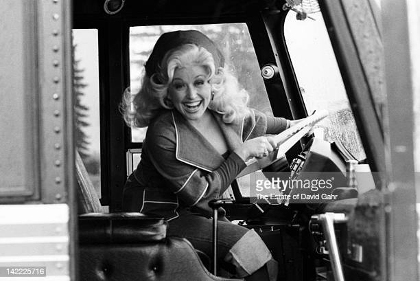 Country artist Dolly Parton in a candid portrait before performing in March 1977 in Battle Creek Michigan