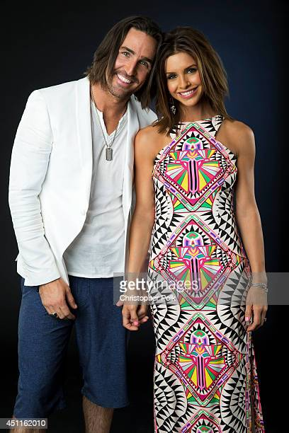 Country artist Jake Owen is photographed with Lacey Buchanan at the CMT Music Awards Wonderwall portrait studio on June 4 2014 in Nashville Tennessee