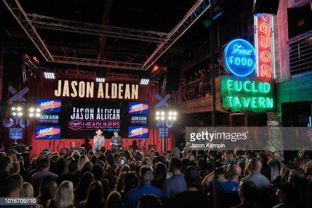 Country artist Jason Aldean and CMT's Cody Alan are seen onstage at Jason Aldean's Kitchen Rooftop Bar on August 9 2018 in Nashville Tennesse