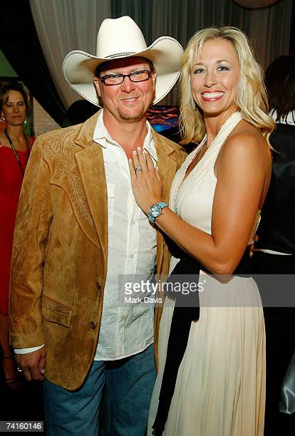Country artists Tracy Lawrence and wife Becca Lawrence pose in the Distinctive Assets gift lounge during the Academy of Country Music Awards held at...