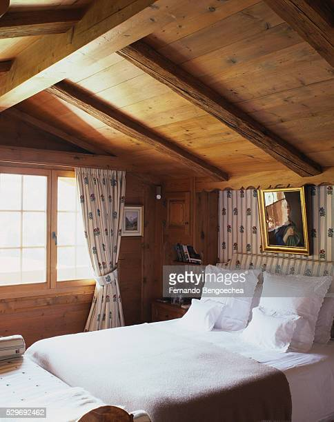 country bedroom with matching fabric accents - fernando bengoechea stock pictures, royalty-free photos & images
