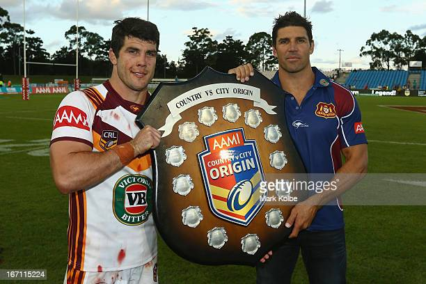 Country captain Michael Ennis and Country coach Trent Barrett pose with the shield after victory in the Origin match between City and Country at BCU...