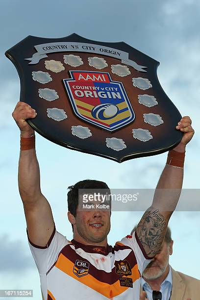 Country captain Michael Ennis holds the shield aloft after victory in the Origin match between City and Country at BCU International Stadium on April...