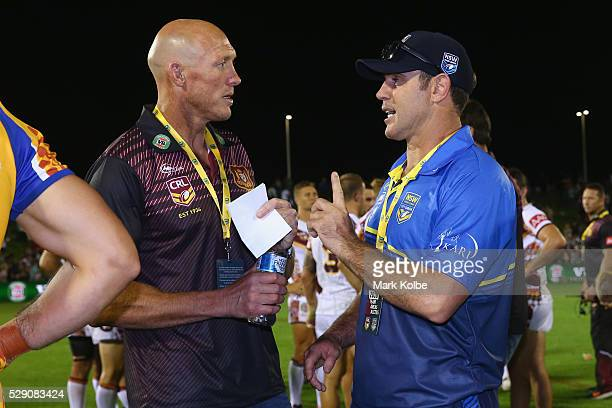 Country coach Craig Fitzgibbon and City coach Brad Fittler speak after the match during the NSW Origin match between City and Country at Scully Park...