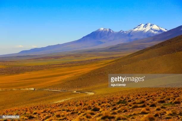 Country dirt road above Lascar Volcano and Idyllic Atacama Desert altiplano, volcanic landscape panorama – San Pedro de Atacama, Chile, Bolívia and Argentina border