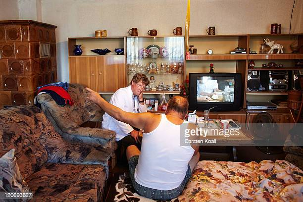 Country doctor Dieter Baermann examined Manfred Seelbinder in the patient's home on August 8 2011 in Sachsendorf near Seelow Germany Baermann works...