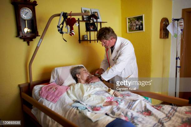 Country doctor Dieter Baermann examined the elderly patient Margot Panzer in the patient's home on August 8 2011 in Alt Tucheband near Seelow Germany...