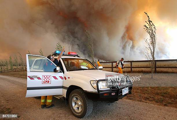 A Country Fire Authority staff monitor a giant fire raging in the Bunyip State Park near Labertouche some 125 kilometres west of Melbourne on...