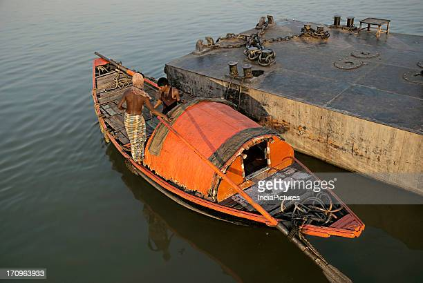 Country fishing boat and fishermen on river Hooghly Kolkata West Bengal India