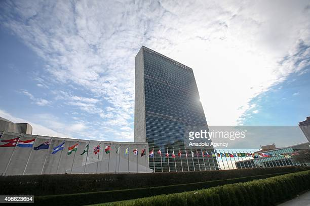 Country flags are seen in front of the United Nations Headquarters in New York United States on November 24 2015