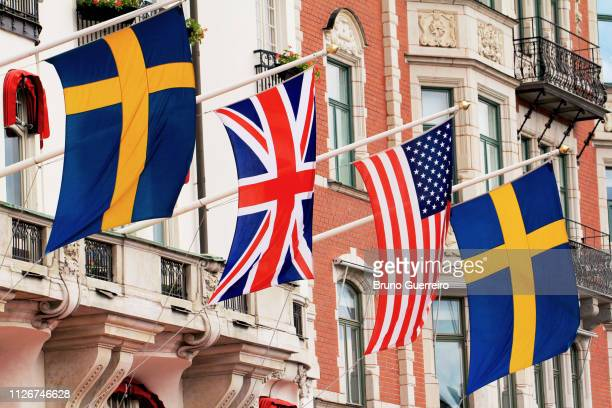 country flags hanging outside building - embassy stock pictures, royalty-free photos & images