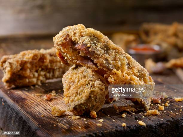 "country fried ""aka"" chicken fried ribs - fried stock pictures, royalty-free photos & images"