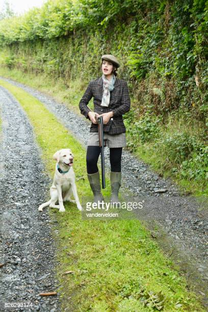 Country gal with her Labrador puppy
