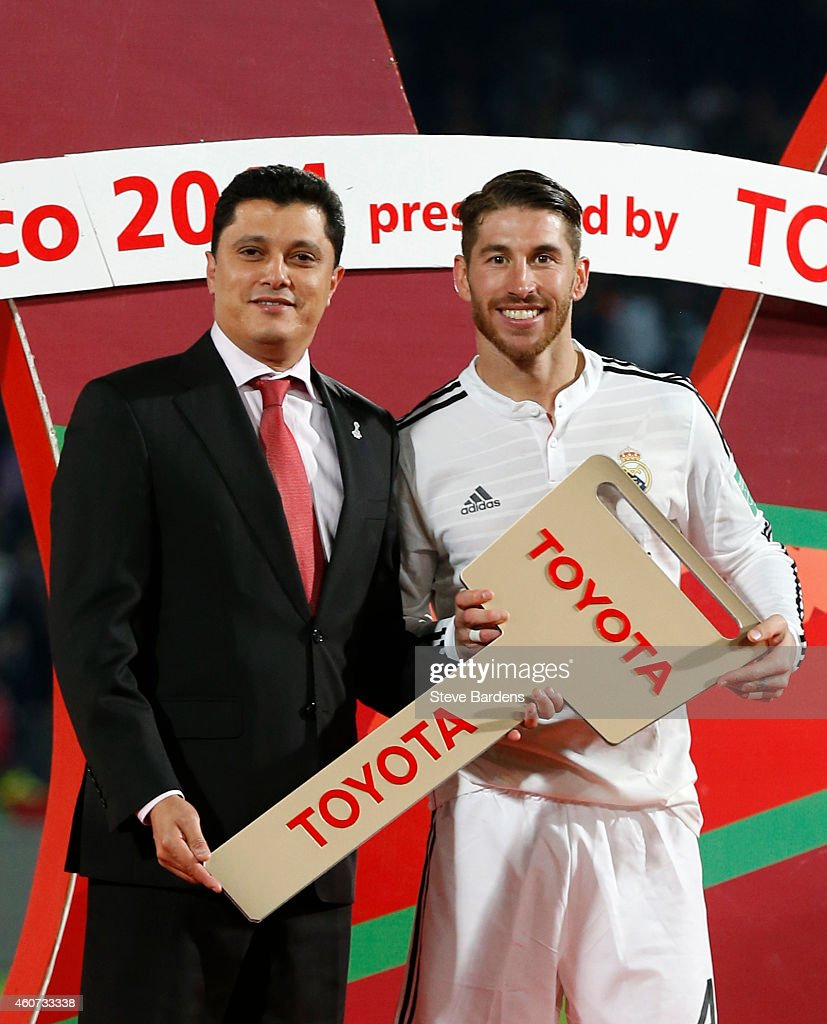 Country General Manager of Toyota du Maroc Adil Bennani Ziatni presents the tournament's MVP Sergio Ramos of Real Madrid CF a giant Toyota key during a presentation ceremony after the FIFA Club World Cup Final match between Real Madrid CF and San Lorenzo at Le Grand Stade de Marrakech on December 20, 2014 in Marrakech, Morocco.