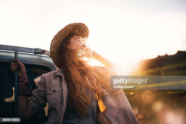 Country girl enjoying nature in the back of a truck