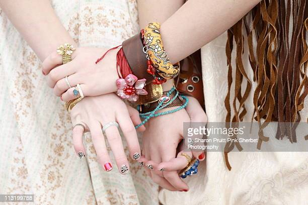 Country girls holding hands with jewelry