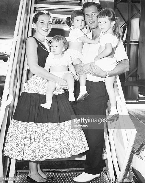 Country gospel singer Pat Boone stands with his wife and three daughters before boarding a plane in New York City The family is Shirley Deborah Ann...