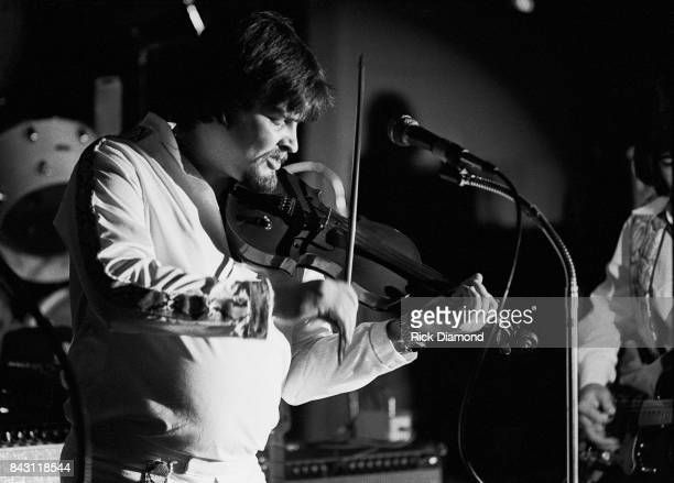 Country Group Alabama L/R Jeff Cook performs at the opening of 'My Home Is Alabama' Nightclub in Birmingham Alabama September 10 1980