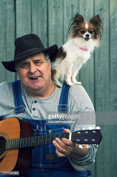 Country Guitar Player with Dog