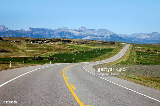 country highway - american style windmill stock pictures, royalty-free photos & images