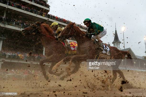Country House ridden by jockey Flavien Prat and Code of Honor ridden by jockey John Velazquez head to the first turn during 145th running of the...