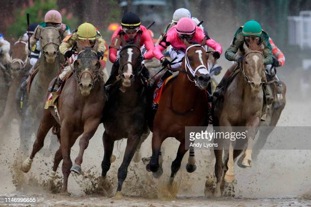 Country House, ridden by jockey Flavien Prat, War of Will, ridden by jockey Tyler Gaffalione , Maximum Security, ridden by jockey Luis Saez and Code...