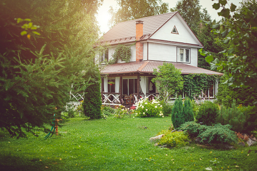 Country house with green back yard in sunny summer day 1096126904