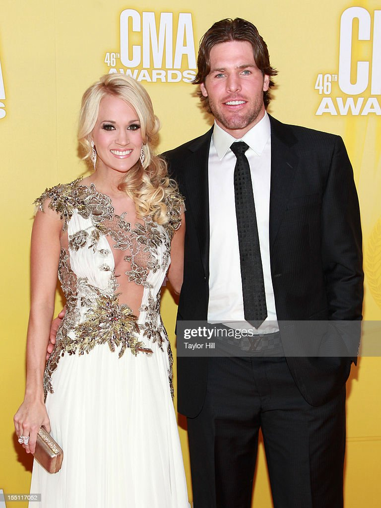 Country music artist Carrie Underwood (L) and Mike Fisher attend the 46th annual CMA Awards at the Bridgestone Arena on November 1, 2012 in Nashville, Tennessee.