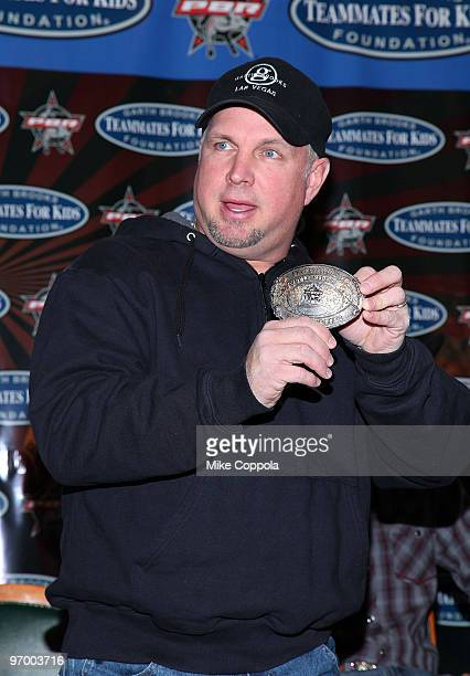 Country music artist Garth Brooks holds up an award at the PBR Garth Brooks Teammates For Kids Foundation press conference at Madison Square Garden...