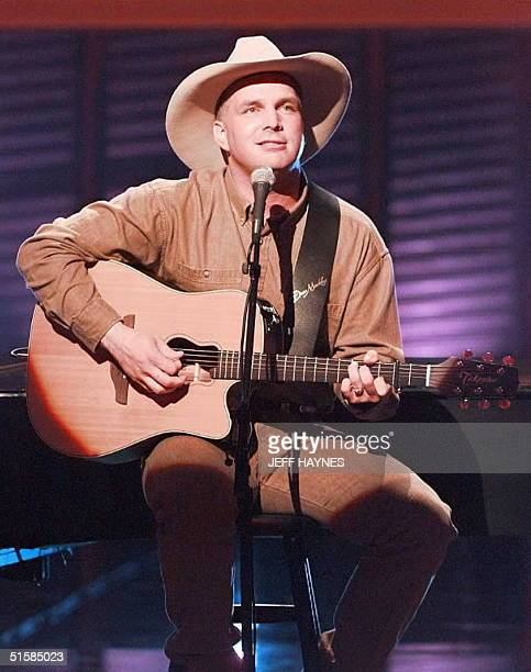 Country music artist Garth Brooks preforms his song Rollin 24 April during the 31st Annual Academy of Country Music Awards held at Universial City...