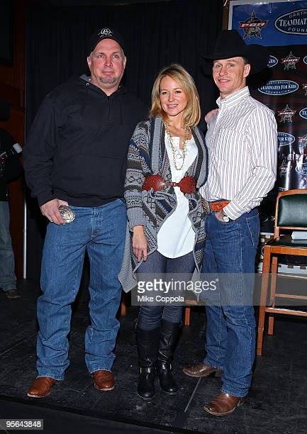 Country music artist Garth Brooks singer Jewel with husband and professional bull rider Ty Murray attend the PBR Garth Brooks Teammates For Kids...