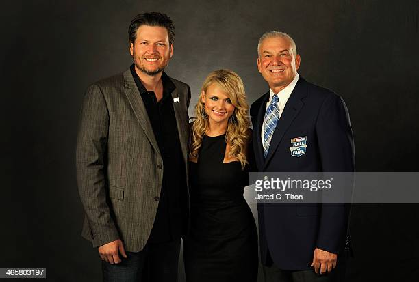 Country music artists Blake Shelton and Miranda Lambert pose with NASCAR Hall of Fame inductee Dale Jarrett during the NASCAR Hall of Fame induction...