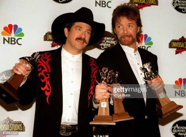 Country music artists Ronnie Dunn and Kix Brooks hold the awards they won during the 31st Annual Academy of Country Music Awards 24 April at...