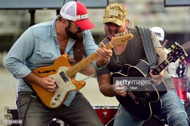 Country music duo Pryor Baird and Kaleb Lee of Pryor & Lee perform from the infield prior to the NASCAR Cup Series Bass Pro Shops Night Race at...
