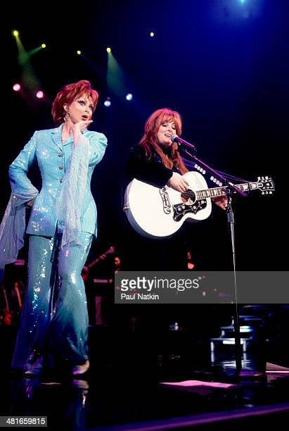 Country music duo the Judds with Naomi Judd and her daughter Wynonna perform onstage Chicago Illinois March 10 2000